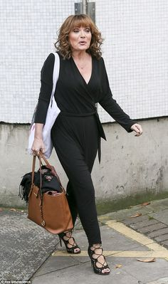 Work it: Lorraine Kelly, 55, strutted out of the ITV studios after her morning show on Wed...