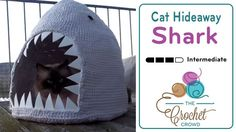 Crochet Cat Hideaway Shark  There's a video on the Crochet Crowd site showing how it's made. If you click on the video title to go to the video on youtube, there are written  instructions in German, which can be translated with Google.