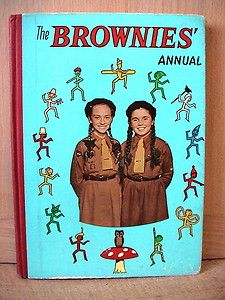 The Brownie Annual. Girl Guides - this was the old style tie that was in fact a triangle of fabric that could be used as a sling and was used in first aid training
