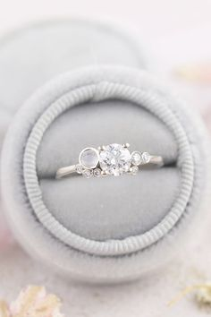 A dainty, unique diamond engagement ring with moonstones Custom Made Engagement Rings, Unique Diamond Engagement Rings, Beautiful Engagement Rings, Vintage Engagement Rings, Dainty Ring, Delicate Rings, Unique Rings, Vintage Ring Box, Wedding Jewelry