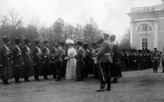 "Tsar Nicholas ll of Russia and Empress Alexandra Feodorovna of Russia review a regiment of officers of His Imperial Majesty's Own Escort in the courtyard of the Alexander Palace,Tsarskoe Selo in 1910. ""AL"""