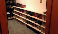 Shoe shelf :) .99 cent cinder blocks and shelves from the home depot. Inexpensive and hold tons of shoes!!