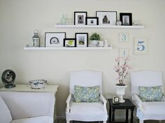 Living room picture shelves with gallery