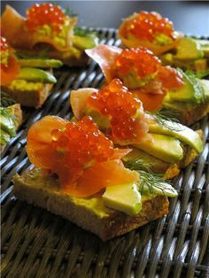 Appetizer with red caviar and avocado.The delicious appetizer for the holiday table with red caviar and avocado