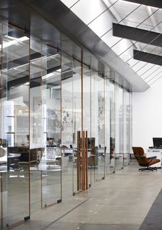 Rosewood-edged glass blades and pivot doors, Fabric Warehouse by Fearon Hay, Auckland NZ Partition Screen, Glass Partition, Interior Architecture, Interior And Exterior, Interior Design, Commercial Design, Commercial Interiors, Warehouse Office, Warehouse Design