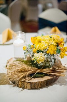 rustic table centerpiece ideas #navywedding #yellowwedding #weddingchicks http://www.weddingchicks.com/2013/12/26/navy-and-yellow-wedding-2/