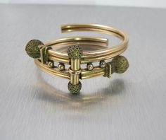 Stunning antique late 1800s Victorian Rose Gold Filled Bypass bracelet. Spring hinged front has a center bar with two round ball shaped ends