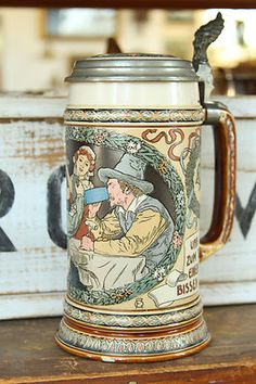 "Look at this wonderful 1 liter German stein! The piece is marked on the bottom ""Mettlach VB Ges Gesch 2716 B 24."" The stein measures 10 1/8 inches high to the top of the lever, which has been made to look like a gargoyle. Fantastic design with flowers and meats. Very good condition with no cracks or breaks. The top has a turnip, a pipe and fish on top. A great item from Germany!"