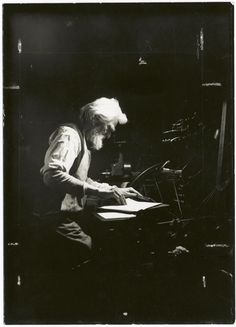 Old time craftsman printer using the old type of foot press (1900-1937)  Photo L.W. Hine  Working conditions in the U.S