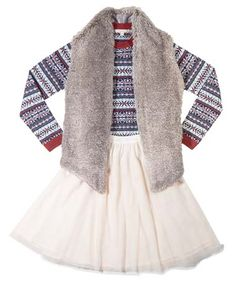 PARTY PLEASER Long-sleeve fair isle crewneck sweater, $98, Brooks Brothers Phillips Place Tart fur vest, $178, Scout & Molly Tulle skirt, $48, Fiore, 704-365-3353