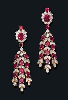 AN ELEGANT PAIR OF RUBY AND DIAMOND EAR-PENDANTS, BY HARRY WINSTON    Each designed as a tassel of graduated cushion-shaped rubies with marquise-cut diamond detail, to the cushion-shaped ruby, circular and marquise-cut diamond cluster top, mounted in 18K gold    Signed and with jeweller's mark for Harry Winston