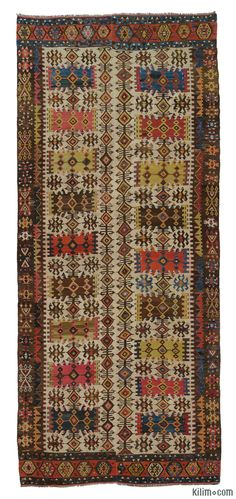 Antique Hotamis Kilim with two wings from Central Anatolia. This finely woven vegetable-dyed rug is around 130 years old