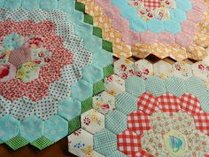 i love grandmother's flower garden quilts and I have one passed down from my great grandmother that needs to be finished.