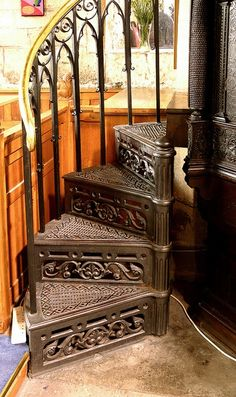 The iron detail on this staircase is beautiful.