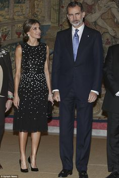 Queen Letizia looks up at her husband with a warm smile as they pose for photos at the eve...