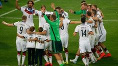 Germany celebrate around the World Cup trophy