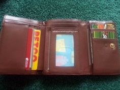 Busy Wallet.  I took one of my old wallets and some old cards I no longer need and stuffed those in there.  I wanted more cards so I took some scrap pieces of paper and laminated them and added them to the wallet too.  Little J was in HEAVEN!  And it was a stress-free activity for us both.