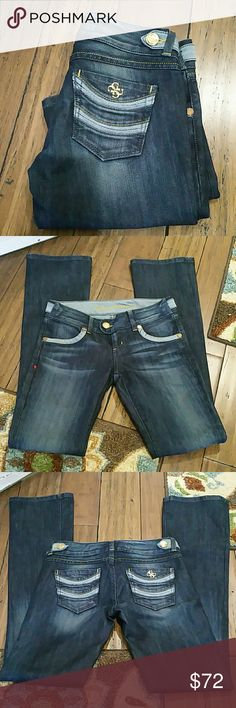 Guess Premium Jeans Size 26  NWOT Dark wash with areas of fade naturally, slight flare .. Beautiful jeans!! Inseam 33 inches  Rise 7 inches 60% cotton  40% polyester Guess Jeans Flare & Wide Leg