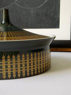 "HANS THEO BAUMANN for Rosenthal 'Studio' Line Lidded [Console] Bowl, Germany, c. 1969 - 1977 | Porcelain; gold geometric design over charcoal grey-dark green background; glazed white on inside; makers marks and ""Hans T. Baumann"" signature on underside; 6"" x 3.5"" | MidCentury FLA"