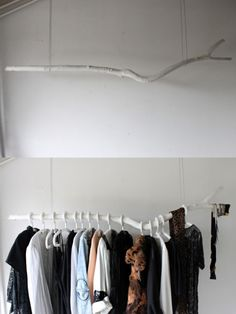 For guest bedrooms without a closet - hang a branch away from the wall to fit hangers straight on.