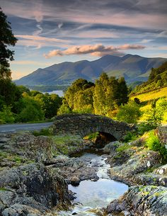 https://flic.kr/p/4VzE4W   A Shady Bridge.   I felt I had to post this photo even though the light on the bridge was wrong.. the clouds over the distant hills, for me, made it worth while.  The bridge is Ashness Bridge, the background mountains/hills are Skiddaw.