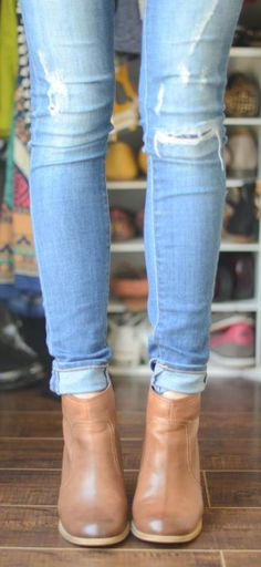 A must this season: boyfriend jeans and booties.