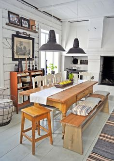 Perfect casual, rustic dining area.  Painted wood floors.  Raised hearth.  metal industrial pendant lights.  LUNDAG On RD |