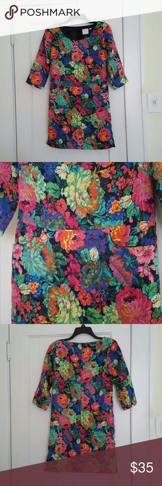 Anthropologie floral multi color half-sleeve dress Beautiful multi-color floral dress from Anthropologie is half-sleeve with two front pockets. Has a back zip and side slit detail at bottom hem of both sides with slight imperfection on right side(picture shows slightly frayed stitching inside of slit). Half-sleeved with slit detail at the end of each sleeve. Dark navy colored inner lining. Snug fit around the thigh area. Anthropologie Dresses Mini