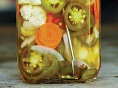 The spicy combination of pickled jalapeños, carrots and onions known as escabeche gets a twist with cauliflower in this recipe from Tacolicious.