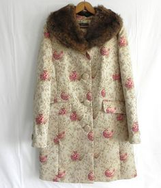 Detachable fur collar makes this beautiful brocade coat stylish and versatile - found it on eBay.