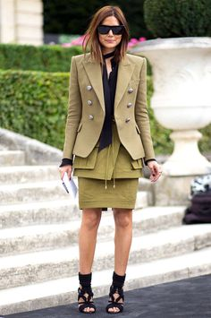 The structure military + safari chic: Christine Centenera wearing black rectangle sunnies and Balmain masculine military green blazer with sculpture peplum safari skirt and knitted black rope booties during #FW2014 #couture fashion week.