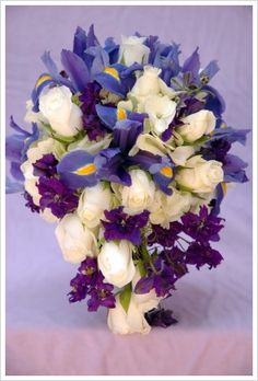 teardrop bouquet of irises, white roses, and purple delphiniums