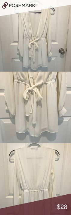 White Romper w/ Bow Tie Front White Romper with Bow Tie Front. Size Small. Perfect going out outfit! Pants Jumpsuits & Rompers