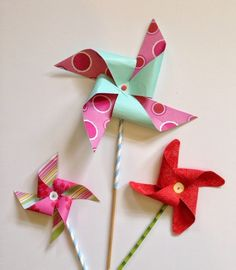 Pinwheels are a nostalgic favorite that have delighted kids for generations. They are so simple to make and with a little imagination you can find new ways to use these clever little whirligigs for parties, decorations and good old-fashioned fun! Since they are so quick to make, you could make a bunch of giant ones in coordinating colors and stick them in flower pots around the patio to create festive party décor. Also great for a unique summer birthday decoration!