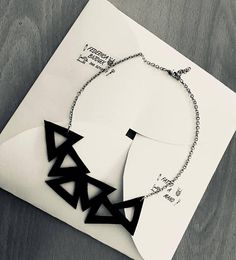 Necklace created with inner tube of bike/car and stainless steel chain. Unique piece because its carved by hand. Original idea to amaze a person dear to you. In the shipment you will also be provided with the necessities to pack the gift.