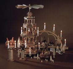 A Schwibbogen is a decorative candle-holder from Germany. Associated exclusively with winter and the holiday season, the first Schwibbogen . Vintage Christmas Lights, Christmas Candle, Christmas Tree, German Christmas, Christmas Angels, Candle Holder Decor, Xmas Decorations, Ceiling Lights, Candles