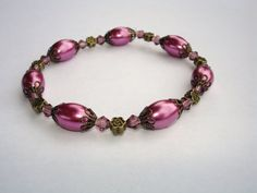 Hey, I found this really awesome Etsy listing at http://www.etsy.com/listing/116183126/purple-bracelet-with-raspberry-wine