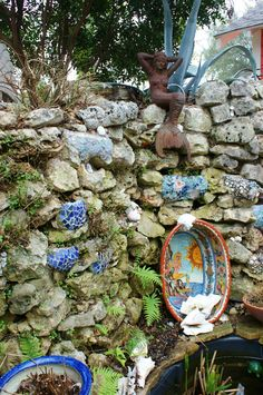 Stone grotto with garden art | by KarlGercens.com GARDEN LECTURES
