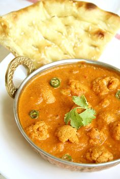 Gobi Butter Masala - Cauliflower { Butter Chicken Style } Need to try this. I have a tonload of cauliflower right now.