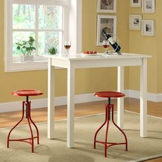 Maybe for the kitchen? Tavern 3 Piece White Pub Table Set - with Ansley Red Adjustable Stools