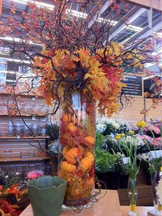 love the tall cylindar with pumpkins in all directions and the leaves billowing out of the top
