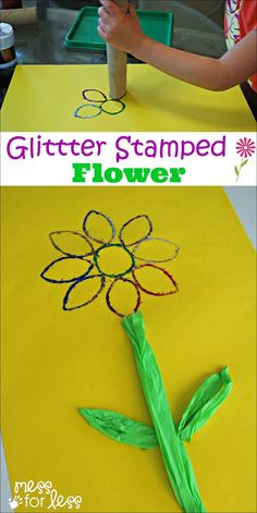 Glitter Stamped Flower Art - it is so easy to make this glitter flower art for kids. It's a great Spring project!