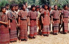 Girls of Atadei, Lembata island - Indonesia. The girls was pictured in Atadei - Lembata Island traditional costume in the early of 90s. The cotton fabric are woven traditionally from the hand spun cotton and natural dyes.  by Ng Sebastian