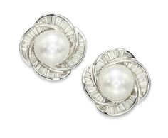 A PAIR OF CULTURED PEARL AND DIAMOND EARRINGS, BY BOUCHERON Each centering upon a round cultured pearl, measuring 15.0 to 14.8 mm, to the graduated baguette-cut diamond surround of whorl design, 2.7 cm, with French assay marks for gold Signed Boucheron, no. P36986