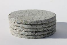 Beautiful handmade concrete coasters made from 98% recycled material primarily consisting of recycled glass and fly ash, a by product of burning coal.