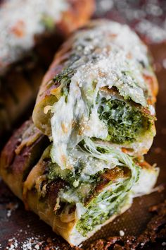 This cheesy pesto garlic bread is packed full of fresh garlic basil pesto and stringy mozzarella cheese. Super simple to make and full of flavor! You'll love how easy this bread side dish is to make!