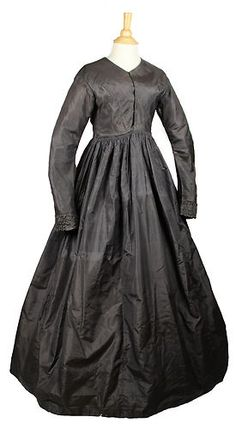 gray/brown (faded black?) silk taffeta - interesting front darts if you can see it up close