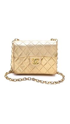 Vintage Vintage Chanel Mini Flap Bag. Buttery, metallic quilted leather composes this authentic vintage Chanel bag.