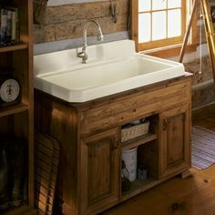 """Features:  -Faucet Holes On Center Deck.  Product Type: -Laundry sink.  Material: -Cast iron.  Country of Manufacture: -United States. Dimensions:  Overall Height - Top to Bottom: -41.5"""".  Overall Len"""