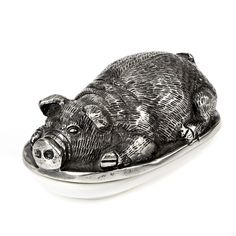 I found this butter dish at HomeSense. It's has a white ceramic base with a pewter pig cover.